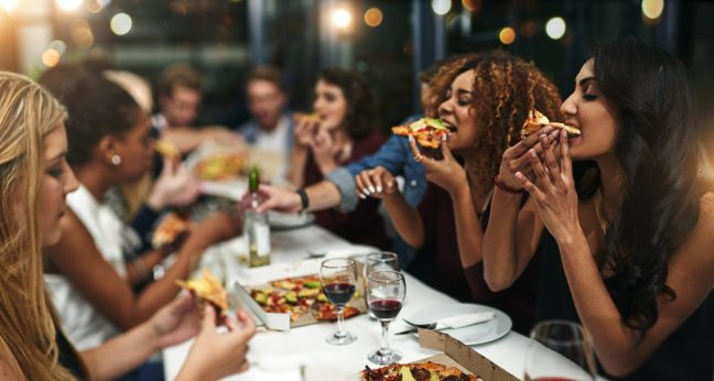 group-of-friends-eating-pizza-and-drinking-wine-e1517317917865